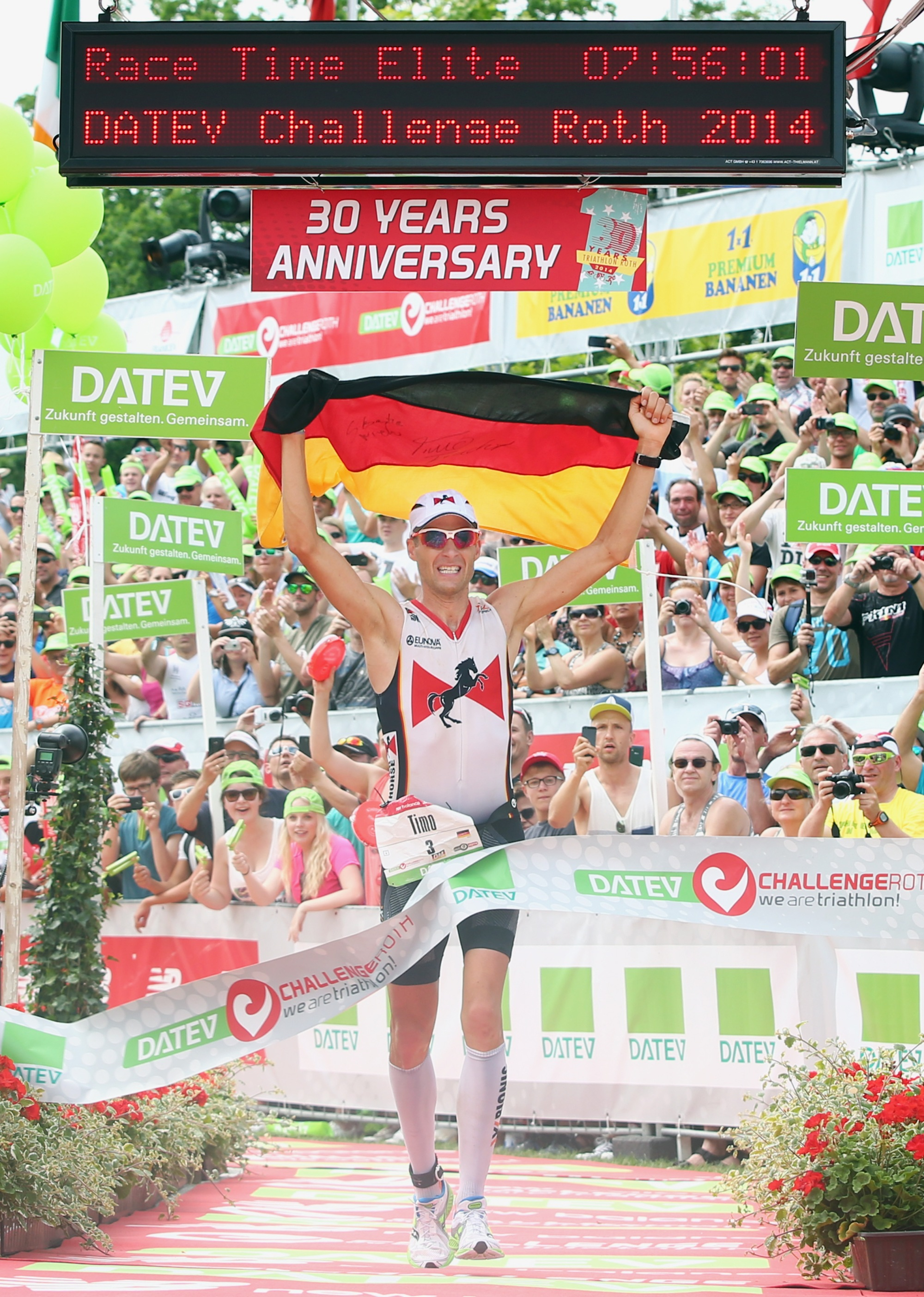 Timo Bracht of Germany celebrates winning the Challenge Roth on July 20, 2014 in Roth, Germany Timo Bracht