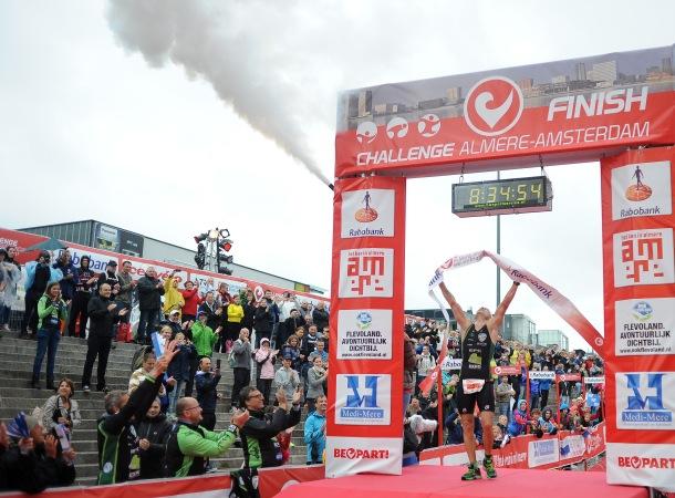 ALMERE, NETHERLANDS - SEPTEMBER 14: Bart Colpaert of Belgium celebrates winning the mens race during the Challenge Triathlon Almere-Amsterdam on September 14, 2013 in Almere, Netherlands.